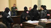 Salah Abdeslam (au centre, assis, le visage flouté) lors de sa comparution devant le tribunal de Bruxelles le 5 février 2018. [Emmanuel DUNAND / AFP/Archives]