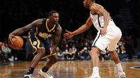 Lance Stephenson (g), des Indiana Pacers, contre les Brooklyn Nets en NBA le 9 novembre 2013 à New York [Maddie Meyer / AFP]