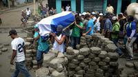 Enterrement d'une victime tuées par les forces progouvernementales à Masaya, ville rebelle du icaragua à 35 km de Managua, le 16 juillet 2018 [MARVIN RECINOS / AFP]