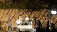 Des enquêteurs sur les lieux où deux hommes ont été tués à Marseille, le 5 février 2016 [BORIS HORVAT                         / AFP]