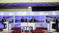 Les candidats à la présidentielle à Madagascar, Andry Rajoelina (à gauche) et Marc Ravalomanana (à droite), lors d'un débat télévisé à Antananarivo, le 16 décembre 2016. [GIANLUIGI GUERCIA / AFP]