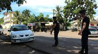 Contrôle de la gendarmerie à Mayotte, dans le cadre de la lutte contre l'immigration clandestine, le 15 mars 2018 [Ornella LAMBERTI / AFP/Archives]