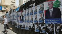 Affiches électorales pour le scrutin législatif qui doit se tenir le 6 mai au Liban, dans un quartier de Beyrouth, le 3 avril [Anwar AMRO / AFP/Archives]