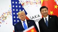 Les présidents américain Donald Trump et chinois Xi Jinping (d) lors du sommet du G20, le 29 juin 2019 à Osaka, au Japon [Brendan Smialowski / AFP/Archives]