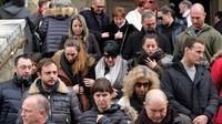 Les fidèles quittent  émus l'église de Trèbes, dimanche 25 mars 2018  deux jours après les attaques terroristes [ERIC CABANIS / AFP]
