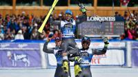 Thomas Fanara, vainqueur du géant de St Moritz, est soulevé par Alexis Pinturault (g), arrivé 2e, et Mathieu Faivre 3e, le 19 mars 2016  [FABRICE COFFRINI / AFP]