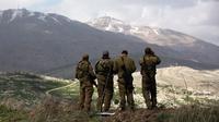 Des soldats israëliens déployés à la frontière syrienne, sur le plateau du Golan, le 19 mars 2014 [Menahem Kahana / AFP/Archives]