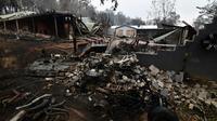 Maisons détruites par un incendie, dans le village de Mogo (sud de l'Australie), le 6 janvier 2020 [SAEED KHAN / AFP]
