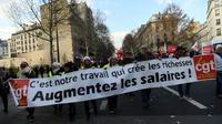 Une des banderoles de la manifestation du 14 décembre 2018 à Paris, à l'appel de la CGT   [CHRISTOPHE ARCHAMBAULT  / AFP]