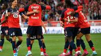Les joueurs de Lille fêtent leur victoire à domicile 2-1 sur Angers en L1 le 13 septembre 2019 [DENIS CHARLET / AFP]