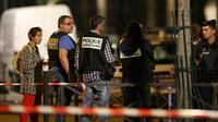 Enquêteurs après l'agression à l'arme blanche qui a fait sept blessés, dont quatre grièvement, le 9 septembre 2018 à Paris [Zakaria ABDELKAFI / AFP/Archives]