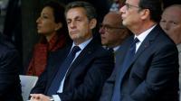 Nicolas Sarkozy et François Hollande lors d'une cérémonie d'hommage aux victimes du terrorisme le 19 septembre 2016 aux Invalides à Paris [JACKY NAEGELEN / POOL/AFP/Archives]