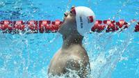 Le Chinois Sun Yang exulte apèrs avoir remporté son 4e titre mondial au 400 m nage libre aux Mondiaux de natation, le 21 juillt 2019 à Gwangju [Ed JONES / AFP]