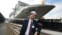 Le directeur général France de MSC Croisières, Erminio Eschena, pose à côté d'un de ses bateaux construits sur le chantier STX de Saint-Nazaire, en 2011 [Frank Perry / AFP/Archives]