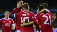 Wayne Rooney, auteur d'un triplé contre le FC Bruges en barrage retour de la Ligue des champions, est félicité par ses coéquipiers, le 26 août 2015 [Emmanuel Dunand / AFP]