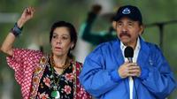 Le président Daniel Ortega et sa femme Rosario Murillo, vice-présidente, lors d'un rassemblement de leurs partisans, le 7 juillet 2018 à Managua, au Nicaragua [Marvin RECINOS / AFP]