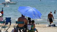 Des vacanciers sur la plage de Palavas-les-Flots, le 28 juin 2019 [Pascal GUYOT / AFP/Archives]