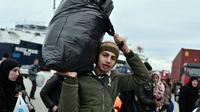 Des migrants à leur arrivée le 10 février 2016 à Lesbos en Grèce [LOUISA GOULIAMAKI / AFP]