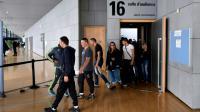 Des prévenus sortent de la salle d'audience du TGI de Grenoble, le 19 septembre 2016 [JEAN PIERRE CLATOT / AFP/Archives]
