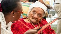 Eudoxie Baboul, le 11 octobre 2015 à Matoury (Guyane) lors d'une messe célébrée à l'intention de cette doyenne des Français, âgée de 114 ans [JODY AMIET / AFP/Archives]