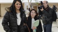 Boucha Bagout et son avocate Gaële Guenoum, à la sortie le 19 décembre 2012 du palais de justice d'Avignon [Anne-Christine Poujoulat / AFP/Archives]