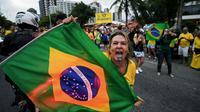 Un supporter de Jair Bolsonaro à Rio de Janeiro le 29 septembre 2018 [CARL DE SOUZA / AFP]