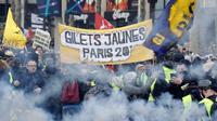 Des Gilets jaunes manifestent à Paris le 16 mars 2019 [Thomas SAMSON / AFP]