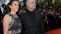 Jean-Pierre Jeunet et son épouse le 18 mai 2013 à Cannes [Anne-Christine Poujoulat / AFP/Archives]