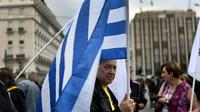 """L'agence de notation financière Moody's a relevé vendredi d'un cran la note de la dette de long terme de la Grèce, passée de """"Caa3"""" à """"Caa2"""", et a également revu sa perspective à """"positive"""" contre """"stable"""" précédemment [ARIS MESSINIS / AFP]"""
