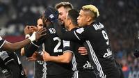 Les Lyonnais vainqueurs du choc de Ligue 1 face à Marseille, le 18 mars 2018 au Vélodrome  [ANNE-CHRISTINE POUJOULAT / AFP]