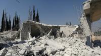 Les ruines d'un bâtiment frappé par les Etats-Unis dans la province d'Alep en Syrie le 1er juillet 2019 [Omar HAJ KADOUR / AFP]
