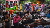 Des Honduriens en marche vers les Etats-Unis se reposent dans la ville de Huitxla, dans le sud du Mexique, le 22 octobre 2018 [Johan ORDONEZ  / AFP]