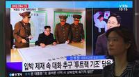 Une femme passe à Séoul devant des écrans montrant le leader nord-coréen Kim Jong-Un le 15 août 2017  [JUNG Yeon-Je / AFP/Archives]
