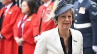 La Première ministre britannique Theresa May arrive le 10 juillet 2018 à l'abbaye de Westminster pour une messe célébrant le centenaire de la Royal Air Force (RAF). [Chris J Ratcliffe / AFP]