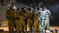 Des soldats israéliens, membres de l'unité Golani, se préparent, avant d'entrer dans la bande de Gaza, le 19 juillet 2014 [Jack Guez / AFP/Archives]