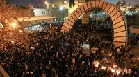 Des étudiants iraniens défilent en hommage aux victimes du crash d'un Boeing ukrainien, le 11 janvier 2020 à Téhéran [Atta KENARE / AFP]