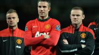 Les joueurs de MU Alexander Buttner, Robin van Persie et Wayne Rooney, après un match de championnat, le 6 mai 2014 à Mancherster [Paul Ellis / AFP]