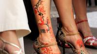 Les jambes d'une jeune femme russe portant des chaussures à talon, à Moscou [Denis Sinyakov / AFP/Archives]