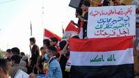 Des manifestants irakiens dans la ville sainte chiite de Kerbala, au sud de Bagdad, le 2 novembre 2019 [Mohammed SAWAF / AFP]