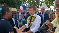 Le président Emmanuel Macron, à M'Tsamboro (Mayotte), le 22 octobre 2019 [Samuel BOSCHER / AFP]