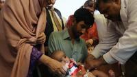 Vaccination d'un bébé le 20 août 2015 à  à Islamabad au Pakistant [Aamir Qureshi / AFP/Archives]