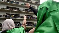 Manifestation dans les rues d'Alger le 8 mars 2019. [RYAD KRAMDI / AFP]