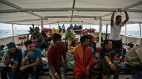 Des migrants secourus par l'ONG Proactiva Open Arms, en Méditerranée le 2 juillet 2018 [Olmo Calvo / AFP/Archives]