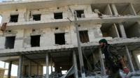 Décombres de bâtiments suite à des combats à Minbej, le 23 juin 2016 [DELIL SOULEIMAN / AFP/Archives]