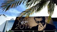 L'affiche officielle du 67e festival de Cannes, sous une palme de la croisette, le 12 mai 2014 [Alberto Pizzoli / AFP]