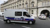 Un véhicule de police à Paris [Kenzo Tribouillard / AFP/Archives]