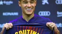 Le milieu de terrain offensif brésilien Phillippe Coutinho lors de sa présentation par le FC Barcelone, le 8 janvier 2018 à Barcelone [LLUIS GENE / AFP/Archives]