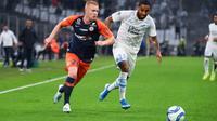 Le milieu de Montpellier Florent Mollet (g) et le défenseur de Marseille Jordan Amavi le 21 septembre 2019 à Marseille  [SYLVAIN THOMAS / AFP]