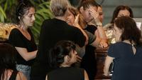 Cérémonie avant l'enterrement de victimes du viaduc qui s'est en partie effondré, dans une chapelle ardente à Gênes, le 17 août 2018 [MARCO BERTORELLO / AFP]