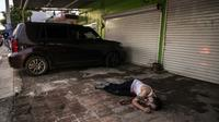 Un corps gît dans une rue de Culiacan, le 17 octobre 2019 [RASHIDE FRIAS / AFP]